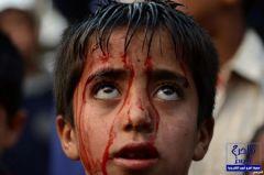 بالصور : احتفالات دموية للشيعة فى عاشوراء وأطفال ملطخون بالدماء