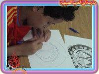 شعار جمعية البر الخيرية بأبداع طلاب مدرسة إبن العميد الصيفية